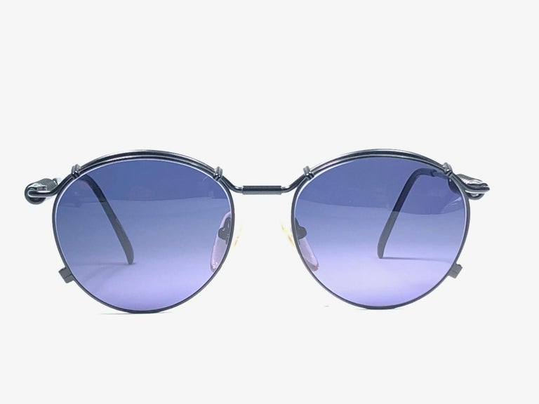 New Jean Paul Gaultier 56 9174 Black & Copper Details frame.  Dark grey lenses that complete a ready to wear JPG look.  Amazing design with strong yet intricate details. Design and produced in the 1900's. New, never worn or displayed. Minor sign of