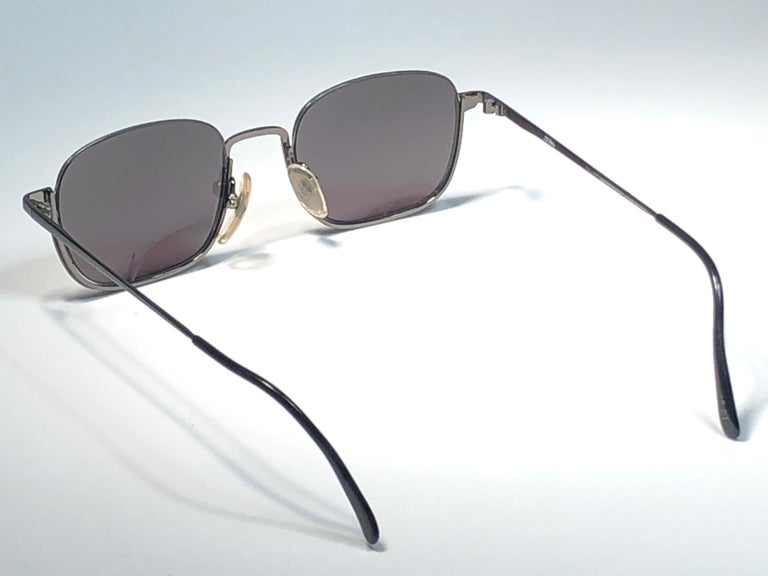 New Jean Paul Gaultier medium half frame grey sunglasses. Spotless smoke grey lenses that complete a ready to wear JPG look.  Amazing design with strong yet intricate details. Design and produced in the 1990's. New, never worn or displayed. This