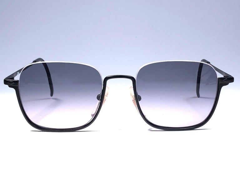 New Jean Paul Gaultier medium half frame sunglasses. Spotless smoke grey lenses that complete a ready to wear JPG look.  Amazing design with strong yet intricate details. Design and produced in the 1990's. New, never worn or displayed. This item may