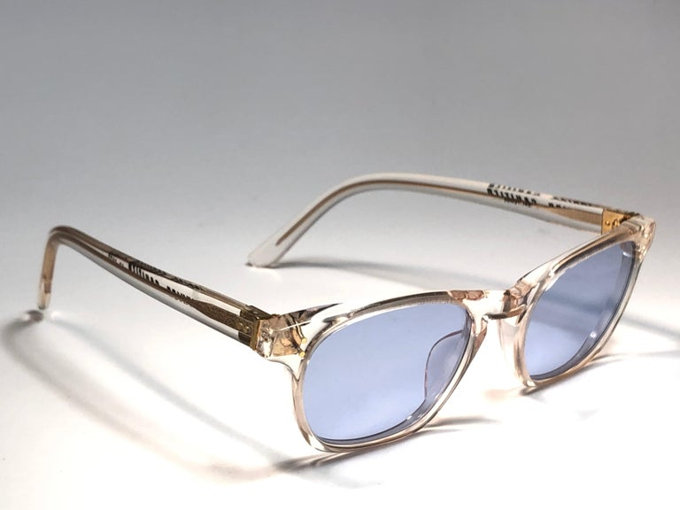 New Jean Paul Gaultier translucent clear  sunglasses. Light blue lenses that complete a ready to wear JPG look.   Design and produced in the 1990's. New, never worn or displayed. This item may show minor sign of wear due to storage. A true fashion