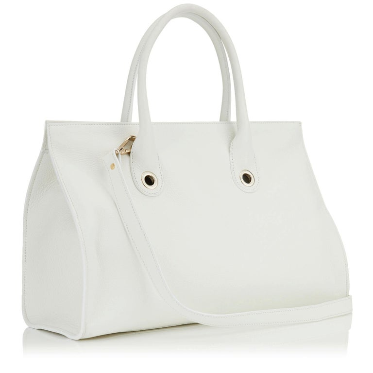 This popular Jimmy Choo Riley's Grainy Calf Leather Cross-body Bag in White. The over sized tote bag is trimmed with gold-toned hardware. The opening features a flip-lock closure at front and 4 protective metal feet on bottom. The removable and
