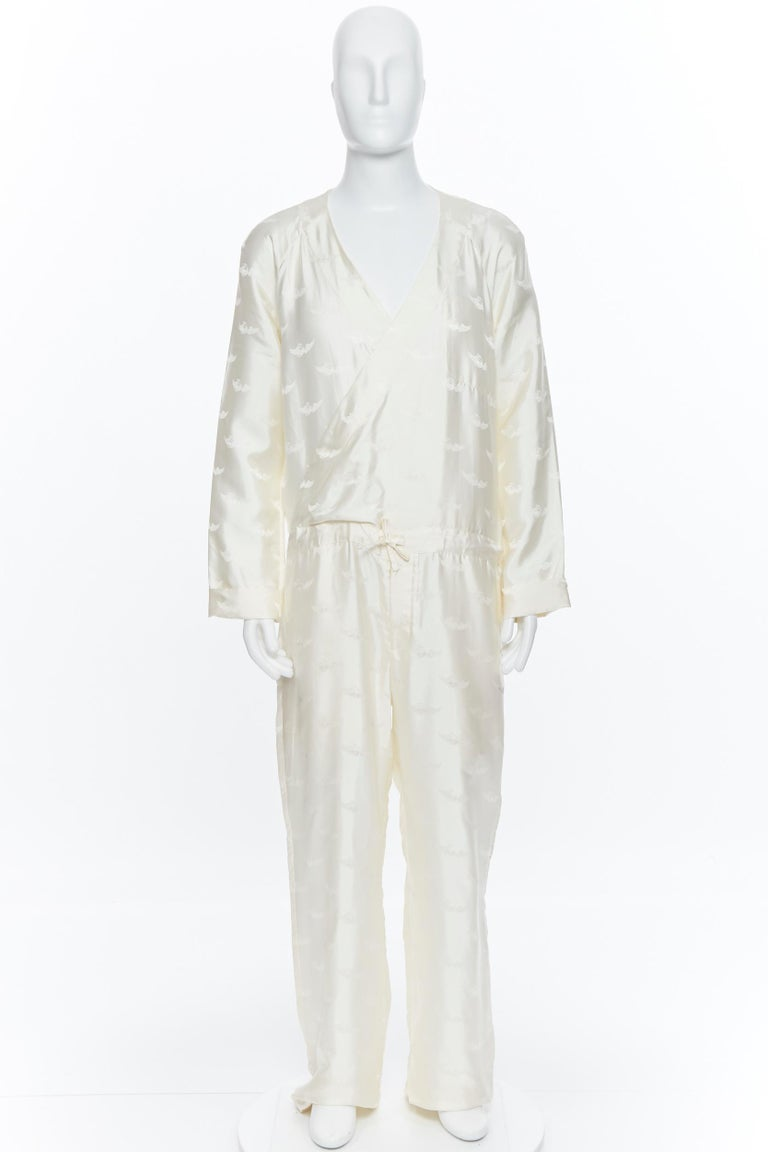 new LA PERLA MENSWEAR 100% silk cream beige winged jacquard V-neck jumpsuit M Brand: La Perla Collection: Spring Summer 2015 Model Name / Style: Silk jumpsuit Material: Silk Color: White Pattern: Abstract; winged jacquard Extra Detail: Can be worn