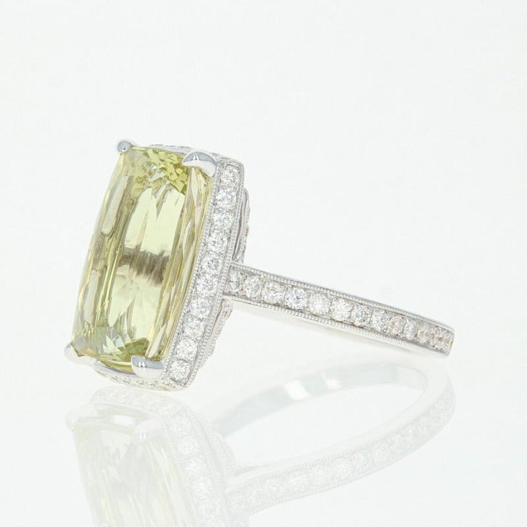 Effervescently sparkling, this glamorous ring is destined to become a signature piece in your fine jewelry collection! This NEW 18k white gold ring showcases a lemon quartz solitaire framed by a milgrain-outlined halo of icy white diamonds which