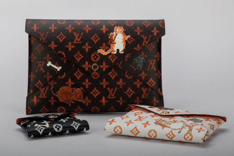 Sold out in stores! New Louis Vuitton Grace Coddington set of three clutches with cats design. Cruise 2019 collection. Comes with booklet, dust cover and box.