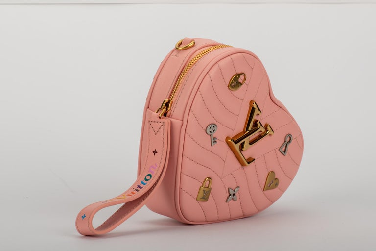 Louis Vuitton limited edition heart shape pink leather bag with logo silver and gold charms. Can we born as a clutch, waist bag or cross body bag. Shoulder strap 20