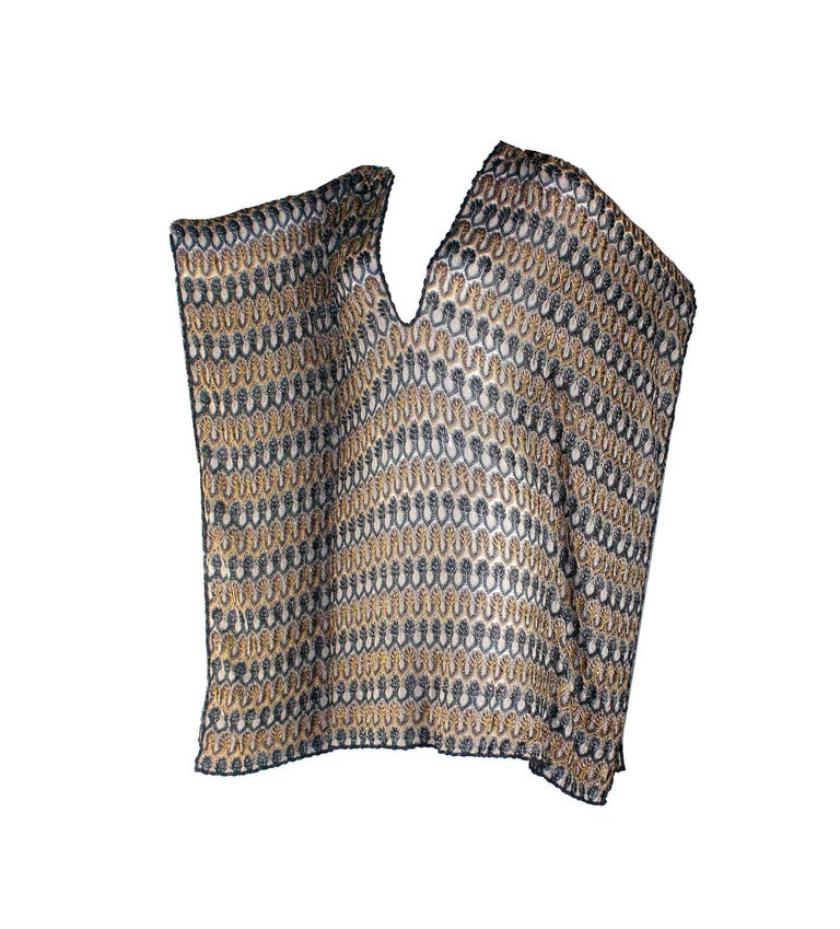 Missoni Mare's kaftan is perfect for slipping over your swimsuit to and from the beach. Crafted from the label's signature metallic crochet-knit, this vibrant piece has a deep v-neck front and a relaxed silhouette. Style yours with sandals by the