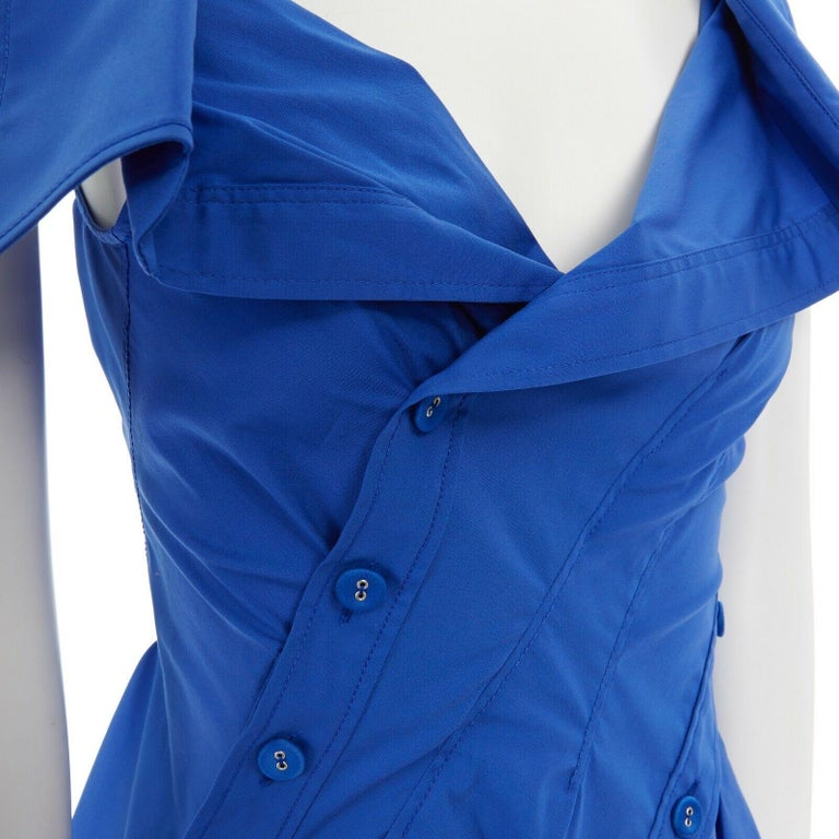 new MONSE electric blue cototn blend deconstructed twisted button blouse top XS  MONSE Cotton blend. Electric blue. Spread collar. Deconstructed twisted top. Curved bodycon seams. Fabric covered button detail. Twisted top. Made in