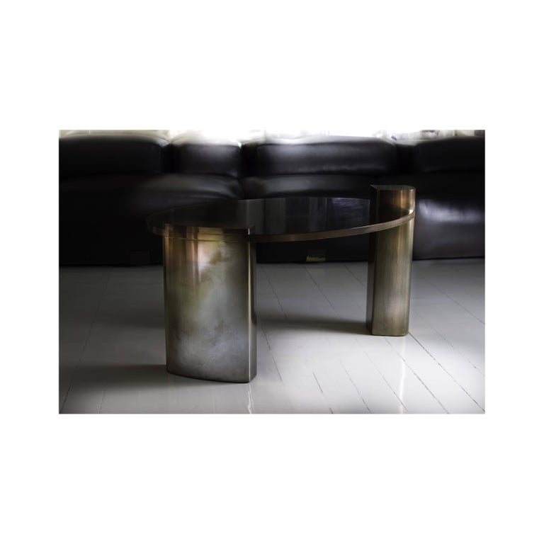 The rose toned hand patinated brass structure and rich mahogany wood veneer surface of the New Moon cocktail table provides a true combination of confidence and imperfection that resonates. This is nothing short of a true statement piece that all at
