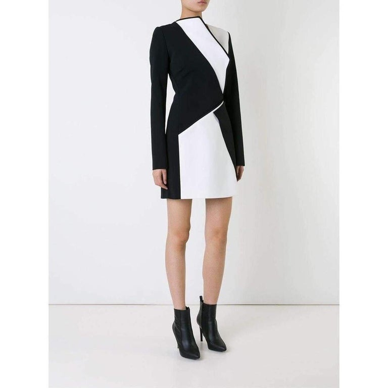 Super-sharp bodycon dresses are Mugler's speciality, and this black and white bonded-crepe design is a slick proposition. Bold monochrome splices are carefully placed to contour the figure, while long sleeves temper the impact of the thigh-high