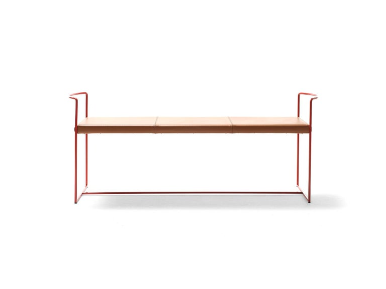 New Outline was developed by maximizing the integration of form and function while using minimum material. The steel rod frame that holds the seat is slender and light. It develops into the side armrests, two barely suggested curves that define the