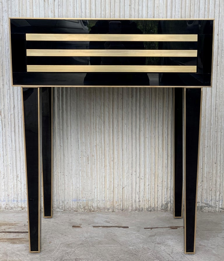 New pair of black glass and brass nightstands with one-drawer in black and white, mirrored details in drawers. Soft push system opening with brake in drawers. Two glass and brass handles   We can make it in custom size or custom color upon