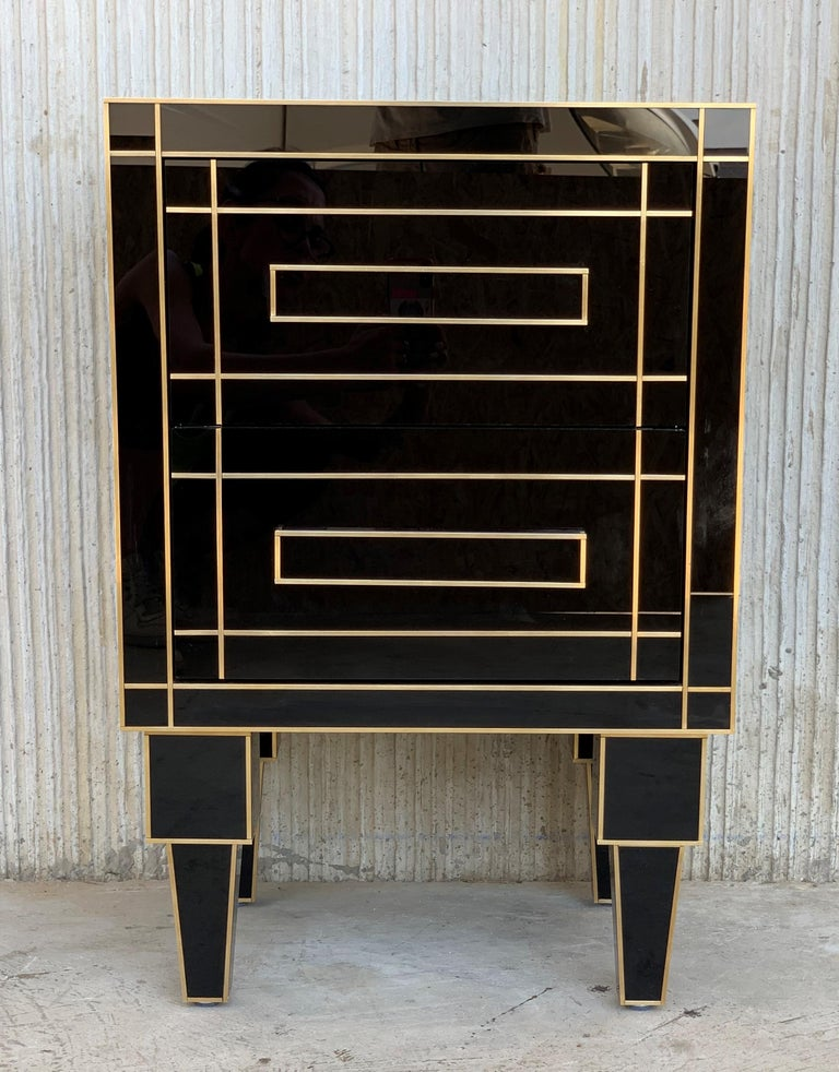 New pair of mirrored nightstands in black mirror and chrome. Beautiful pair of nightstands with mirrored finished drawers. Brass handle and mirrored finishes in the edges of drawers. Measures: Drawers Height: 6 in Legs Height: 10 in.