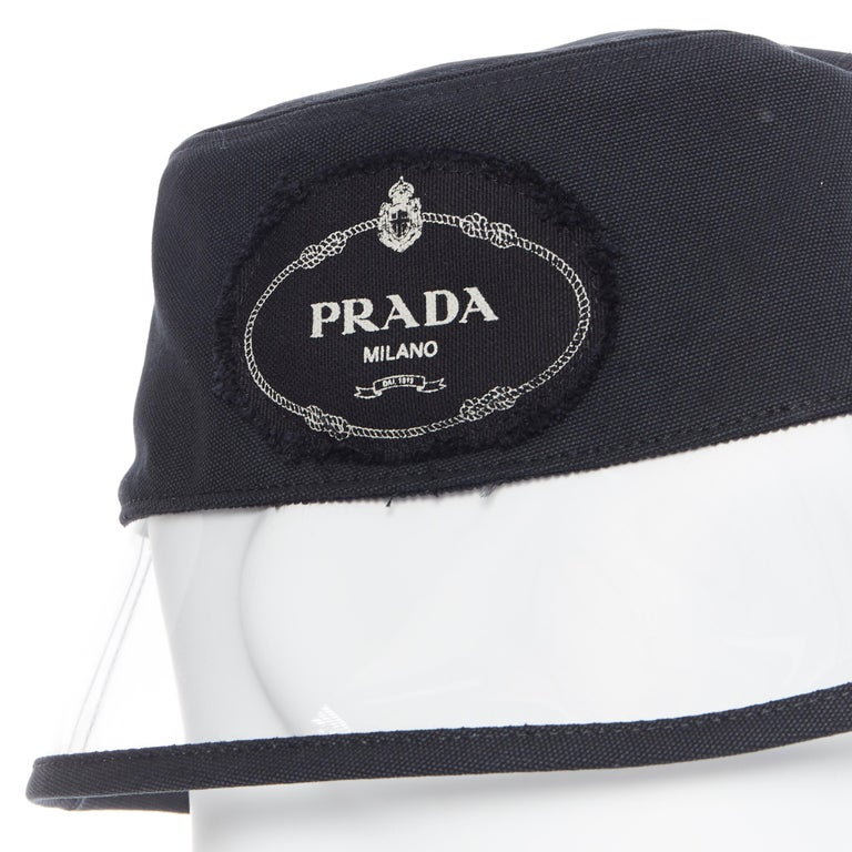 new PRADA 2018 black cotton frayed logo clear PVC brim shield 90's bucket hat M Brand: Prada Designer: Miuccia Prada Collection: Spring Summer 2018 Model Name / Style: Bucket hat Material: Cotton, PVC Color: Black Pattern: Solid Extra Detail: Very
