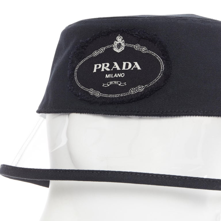 new PRADA 2018 black cotton frayed logo clear PVC brim shield 90's bucket hat S Brand: Prada Designer: Miuccia Prada Collection: Spring Summer 2018 Model Name / Style: Bucket hat Material: Cotton, PVC Color: Black Pattern: Solid Extra Detail: Very