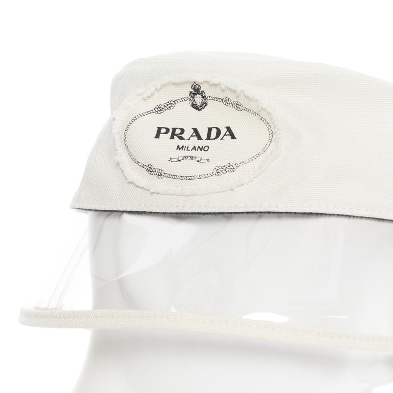 new PRADA 2018 cream cotton frayed logo clear PVC brim shield 90's bucket hat M Brand: Prada Designer: Miuccia Prada Collection: Spring Summer 2018 Model Name / Style: Bucket hat Material: Cotton, PVC Color: White Pattern: Solid Extra Detail: Very
