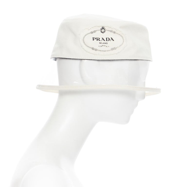 new PRADA 2018 cream cotton frayed logo clear PVC brim shield 90's bucket hat M In New Condition For Sale In Hong Kong, NT