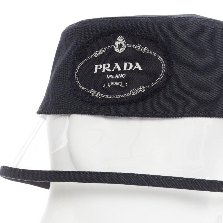 new PRADA 2018 RARE black cotton frayed logo clear PVC trim 90's bucket hat S Brand: Prada Designer: Miuccia Prada Collection: Spring Summer 2018 Model Name / Style: Bucket hat Material: Cotton, PVC Color: Black Pattern: Solid Extra Detail: Very