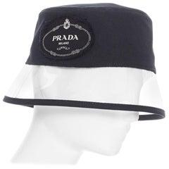 new PRADA 2018 RARE black cotton frayed logo clear PVC trim 90's bucket hat S