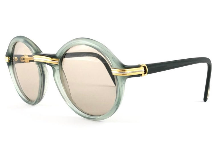 New ultra rare size 1991 Original Cartier Cabriolet Art Deco Translucent Jade sunglasses with grey slight mirrored ( uv protection ) lenses. Frame has the famous real gold and white gold accents in the middle and on the sides.  All hallmarks.
