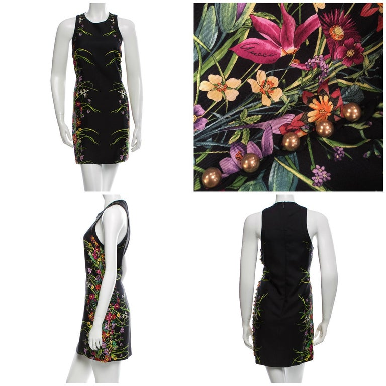 Gucci Flora Silk Dress Brand New S/S 2013 * Retail $1475 * Iconic Black Flora Fabric * Euro Size: 40 Size: 4 * Classic Flora Design Gucci Signature Throughout the Dress *Zips Up the Back * Fully Lined * Button Accent Up One Side  Bust: 34