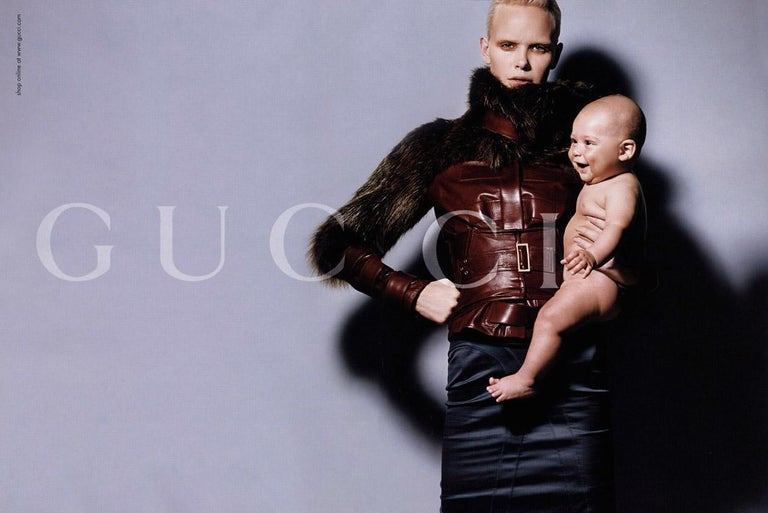 Gucci Brand New Without Tags Rare Tom Ford for Gucci Featured in Ad, Runway and Video F/W 2003 $9,650 Size 40  U.S. Size 2/4  Stunning Chocolate Brown Leather Thick Fox Fur & Leather Sleeves Button Closure at Front Buckle Accent at Sleeve Two Front