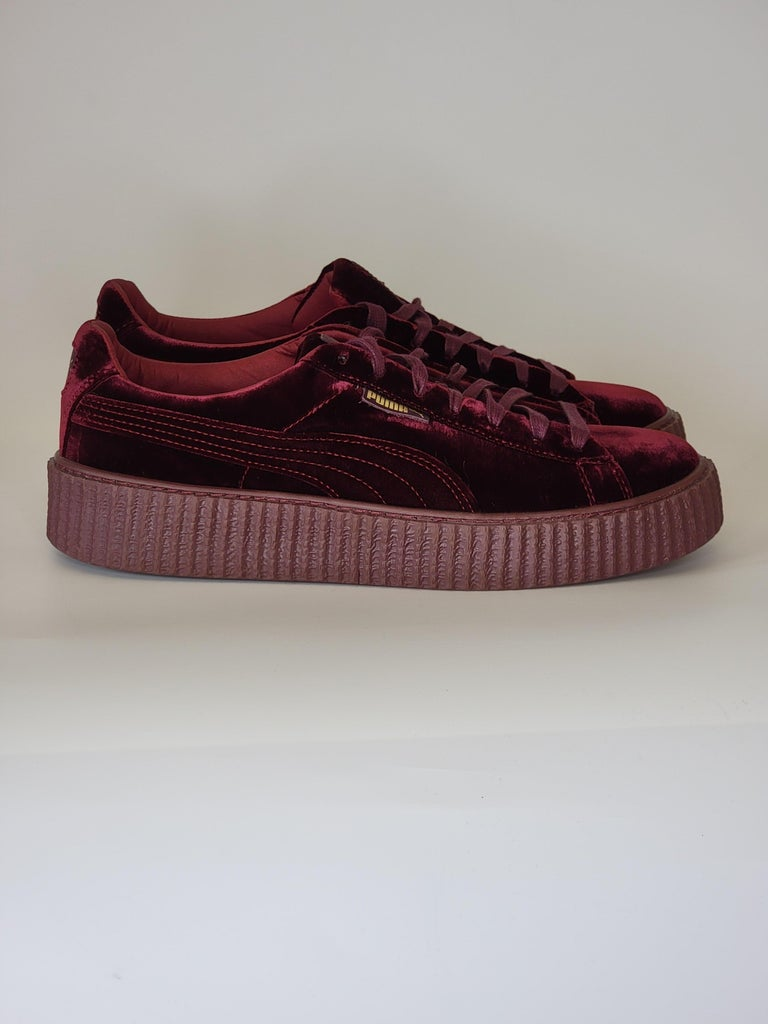 Burgundy velvet low top sneakers created by a Collab between Fenty by Rihanna and Puma.  Creeper sneakers with lace-up closures, tonal stitching and rubber platform soles. Sold out.   COLOR: Burgundy MATERIAL: Velvet SIZE: 11 US / 44 EU PLATFORM