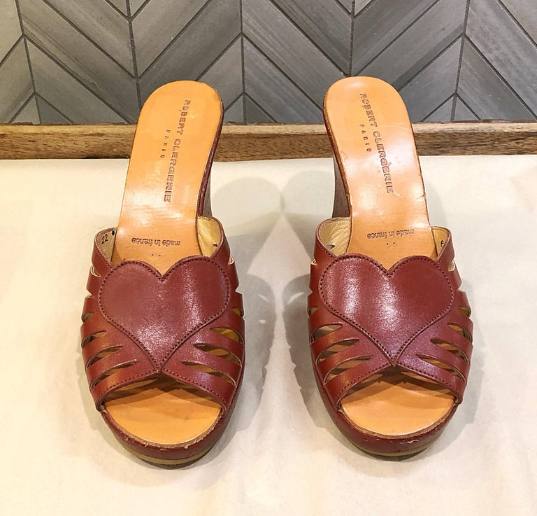 New never worn 90s ROBERT CLERGERIE cordovan / brown Size 6.5 leather wedges! Features a chic heart shape at center foot. Perforated details along the bed of each shoe. Can easily be dressed up or down. Great with jeans, shorts, a skirt or