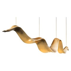 New Suspension Lamp in Resin Finished in Pale Gold Color