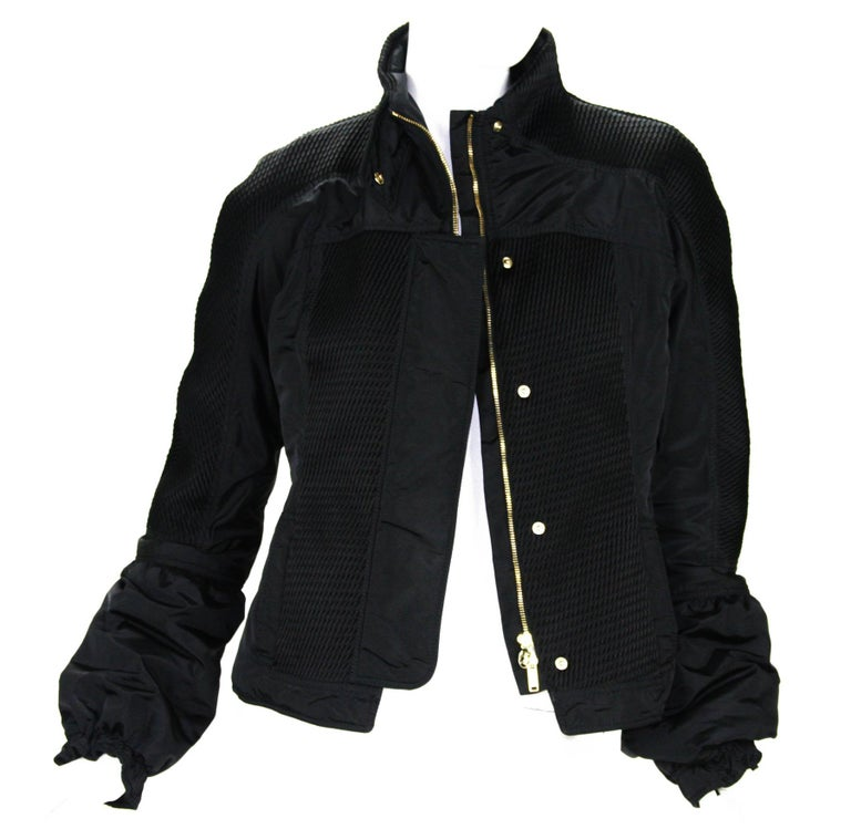 Tom Ford for Gucci Black Nylon Warm Jacket F/W 2004 Collection Designer size 44 Jacket created for the cold weather, Hidden zip front closure and snaps, Two side pockets, Bell sleeves with elastic at the end, Two side pockets,  Fully lined in same