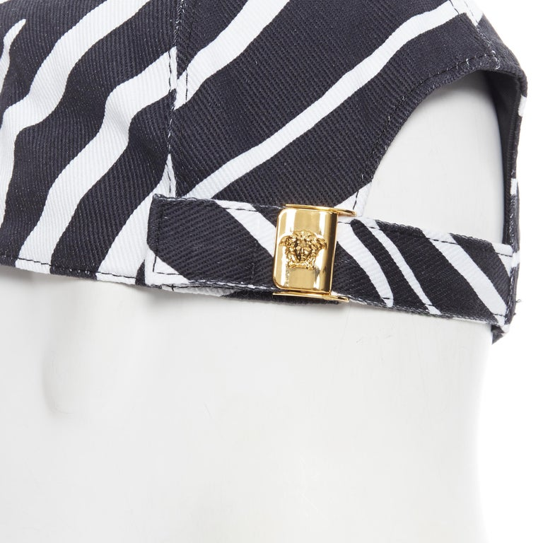 new VERSACE 2019 black white zebra srtipe cotton gold Medusa buckle cap hat 57 Brand: Versace Designer: Donatella Versace Collection: 2019 Model Name / Style: Zebra cap Material: Cotton Color: Black, white Pattern: Animal print Closure: Buckle Extra