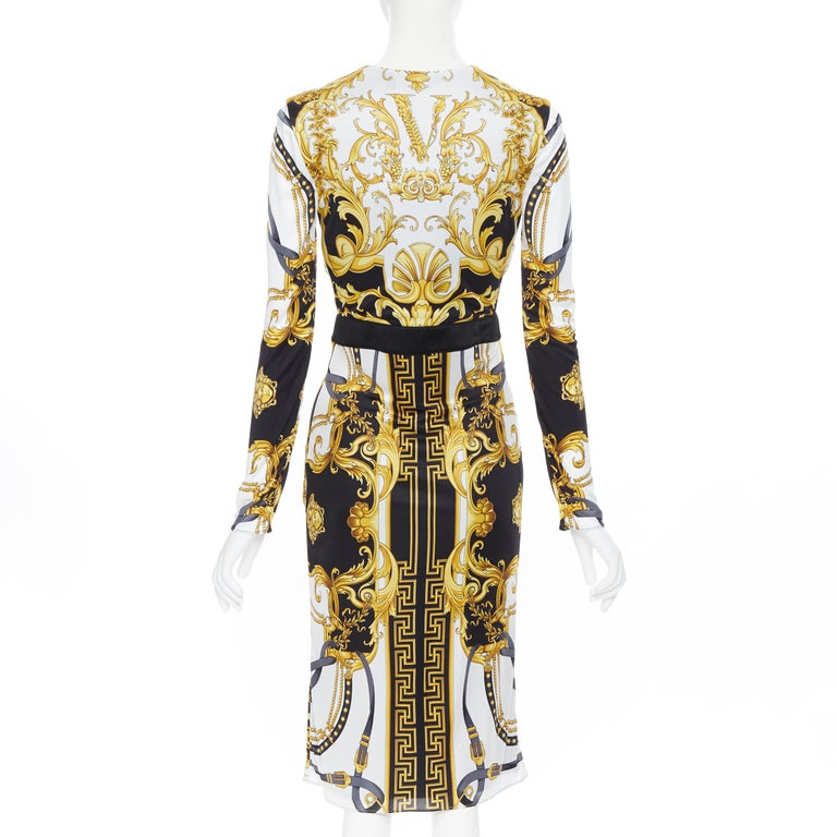 new VERSACE black gold baroque bondage strap virtus print wrap dress IT38 Brand: Versace Designer: Donatella Verasce Collection: SS2020 Model Name / Style: Wrap dress Material: Viscose Color: Gold, black Pattern: Floral Closure: Button Extra Detail: