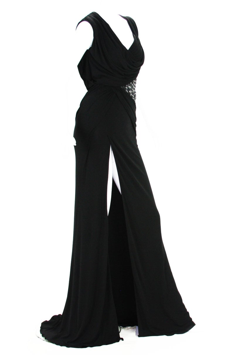 New Versace Black Jersey Long Dress Gown Designer size 40 -  US 6 Black Jersey, High Side Slit, Build in Leotard Bottom Underlay, Side Zip Closure, Fully Lined in Same Jersey Fabric. Leather, Beads and Sequins Embellishment Over the Tulle. Made in