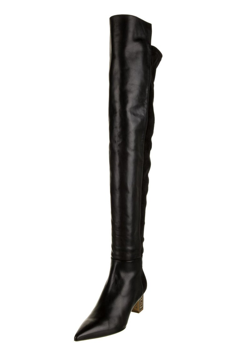 New Versace Black Greek Key Heel  Thigh High Boots Designer sizes available - 38 and 39. Black Leather and Stretch Suede, Over the Knee Style, Gold Tone Metal Greek Motive Heel, Side Half Zip Closure, Pointed Toe Silhouette. Measurements Approx.: