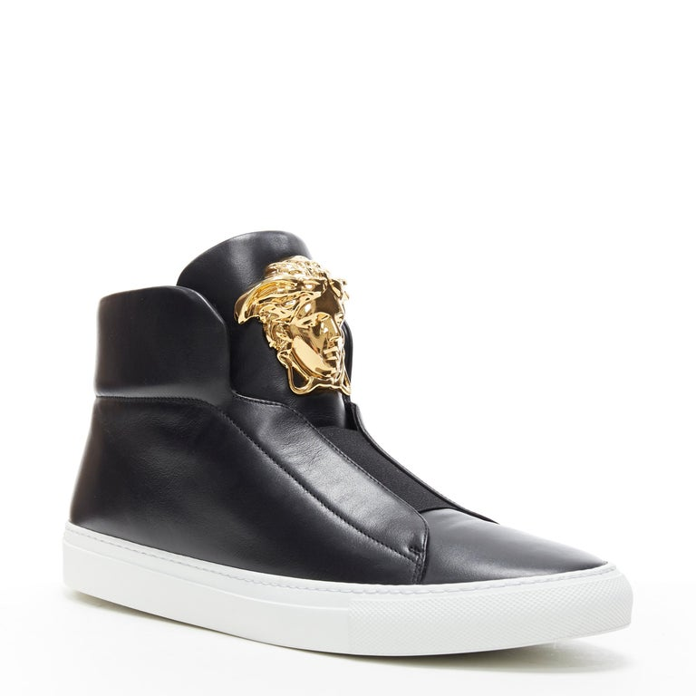 new VERSACE Palazzo gold Medusa black calfskin leather high top sneaker EU40 Brand: Versace Designer: Donatella Versace Model Name / Style: Palazzo high top Material: Leather; calfskin leather Color: Black; gold Medusa Pattern: Solid Closure: