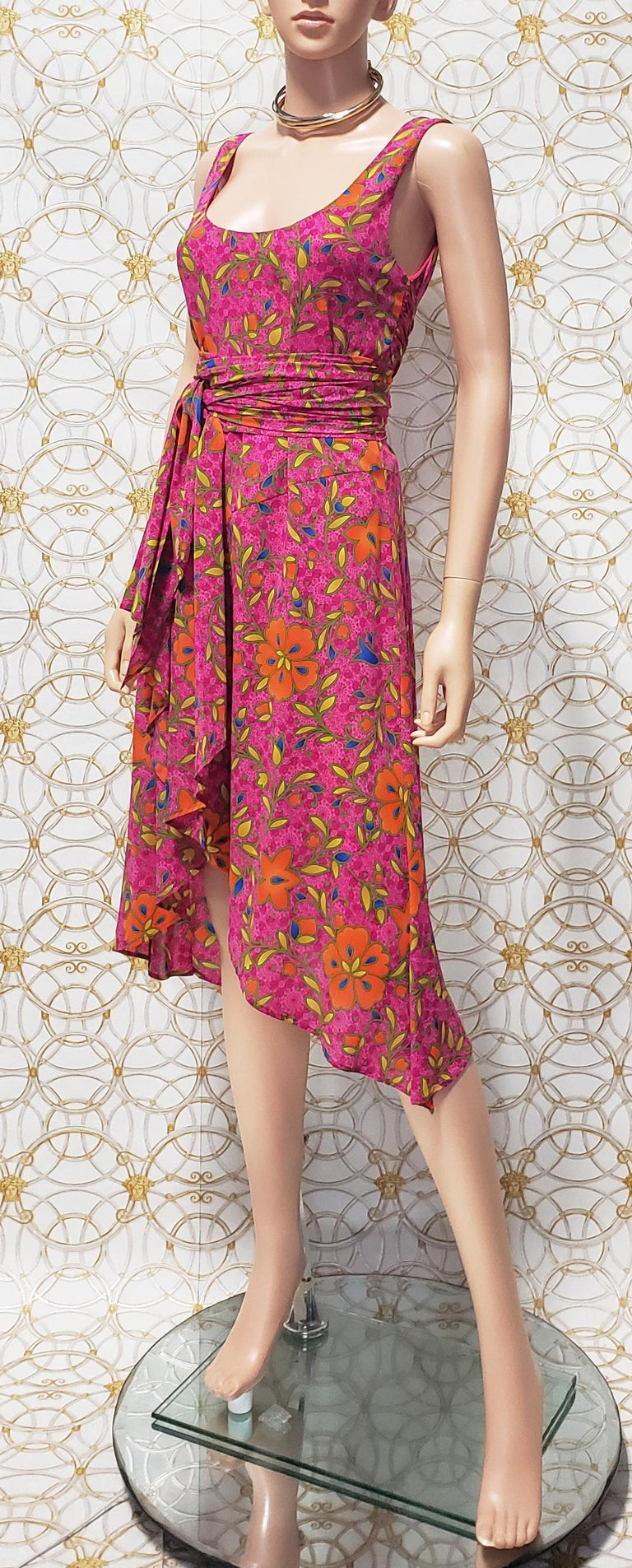 VERSACE SILK DRESS     Stretch silk with floral print is shaped into one of the most beautiful dresses.  Discrete back zipper Flared wrap skirt Uneven hem Wrap ties at side Fully lined Made in Italy  Content: 91% silk and 9% spandex  Made In