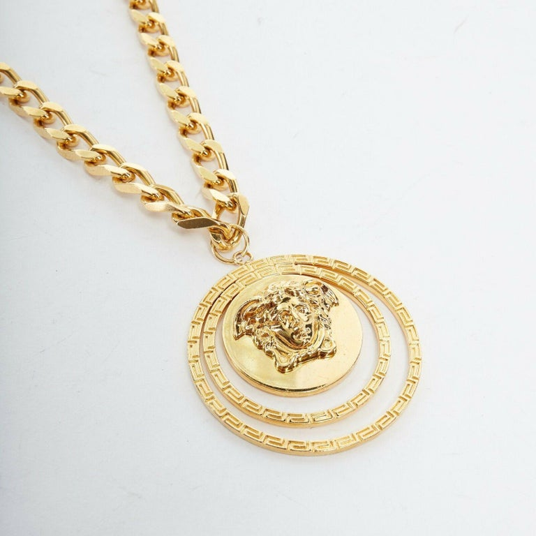 new VERSACE polished gold Medusa medallion triple halo chunky chain necklace  VERSACE Versace polished gold plated brass necklace. Versace head medallion gold-tone medallion coin pendant. Triple halo circle design in Grecian baroque emboss. Thick