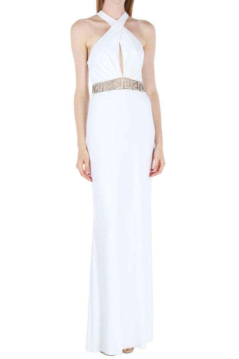 New Versace Swarovski Crystals White Jersey Dress Gown Designer size 42 White Stretch Jersey, Swarovski Crystals Embellishment, Built in Leotard Bottom Underlay, High Slit at Back, Fully Lined, Back Zip Closure. Measurements: Length - 64 inches,