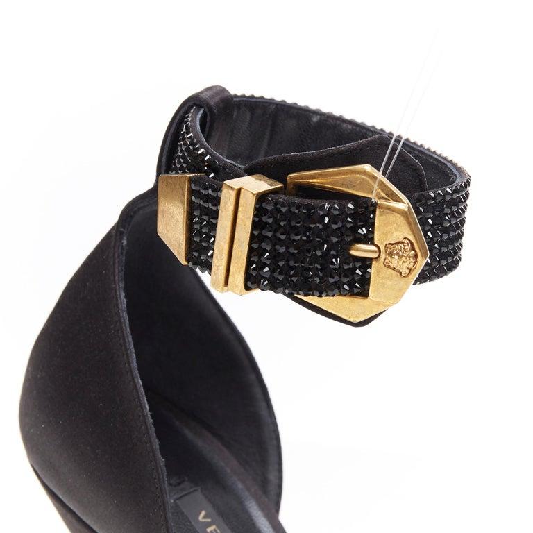 new VERSACE Tribute black strass crystal gold Medusa buckle strappy sandal EU39 Brand: Versace Designer: Donatella Versace Collection: Spring Summer 2018 Model Name / Style: Buckle sandals Material: Silk; crystal embellishment Color: Black Pattern: