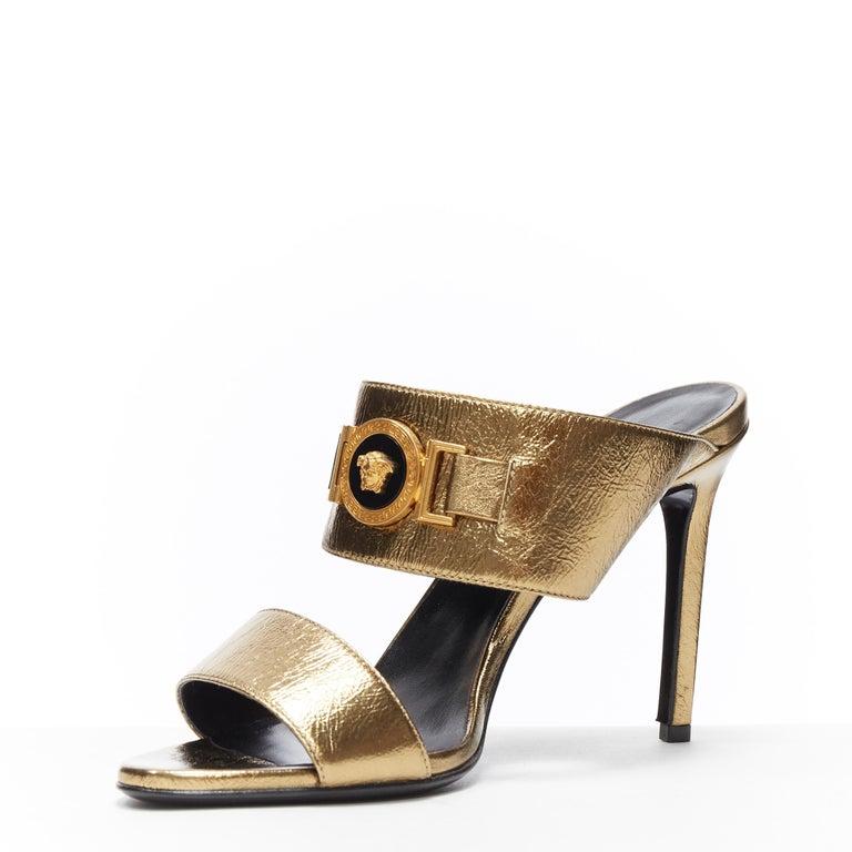 Women's new VERSACE Tribute metallic gold Medusa charm open toe strappy heel mule EU39 For Sale