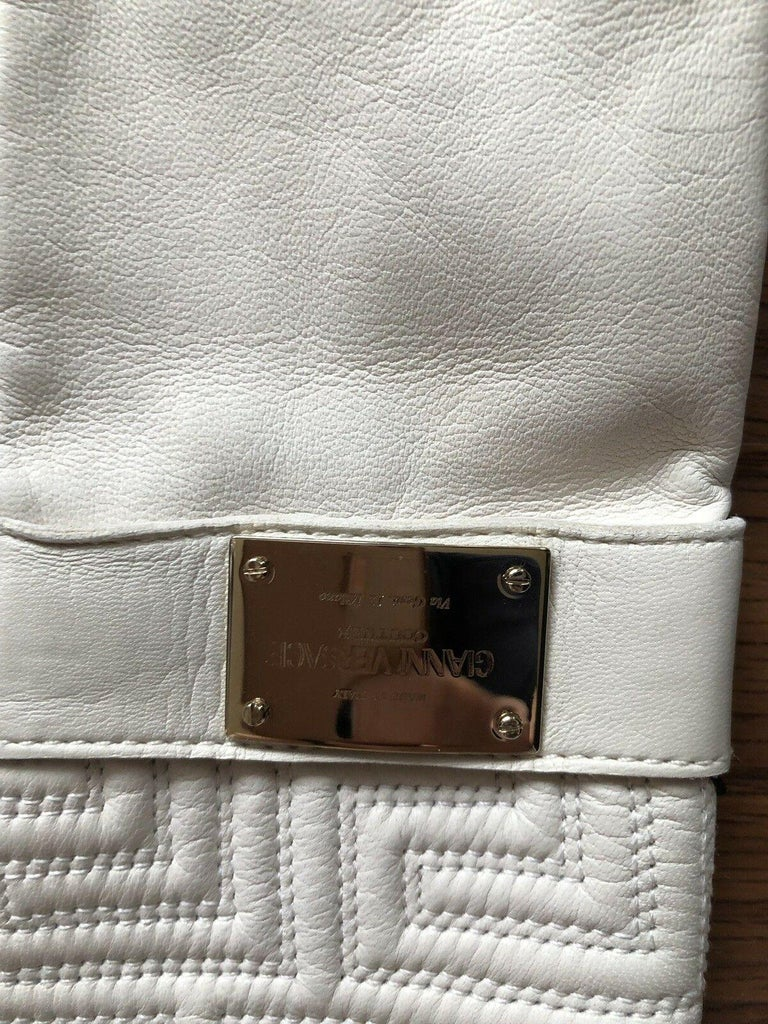 Gianni Versace White Leather Gloves  Condition - New with tags  White Versace gloves with silk lining and tonal stitching throughout.