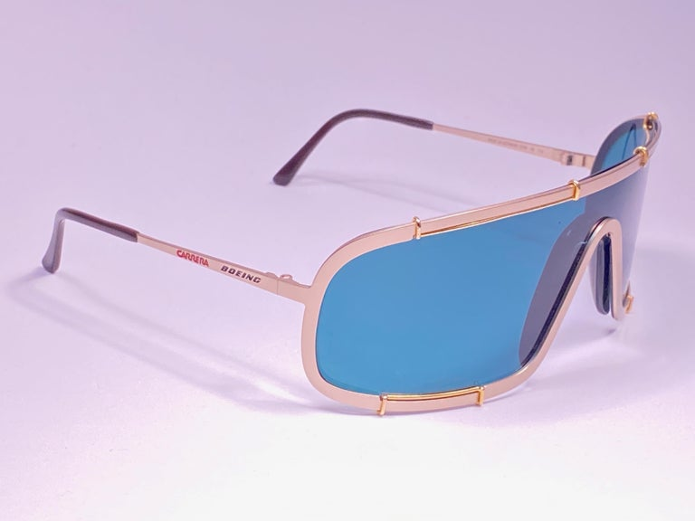New 1980's Boeing by Carrera mono gold frame with turquoise lenses.   Amazing craftsmanship and quality.      New, never worn. Made in Austria.  This item show minor sign of wear on the lenses due to storage.
