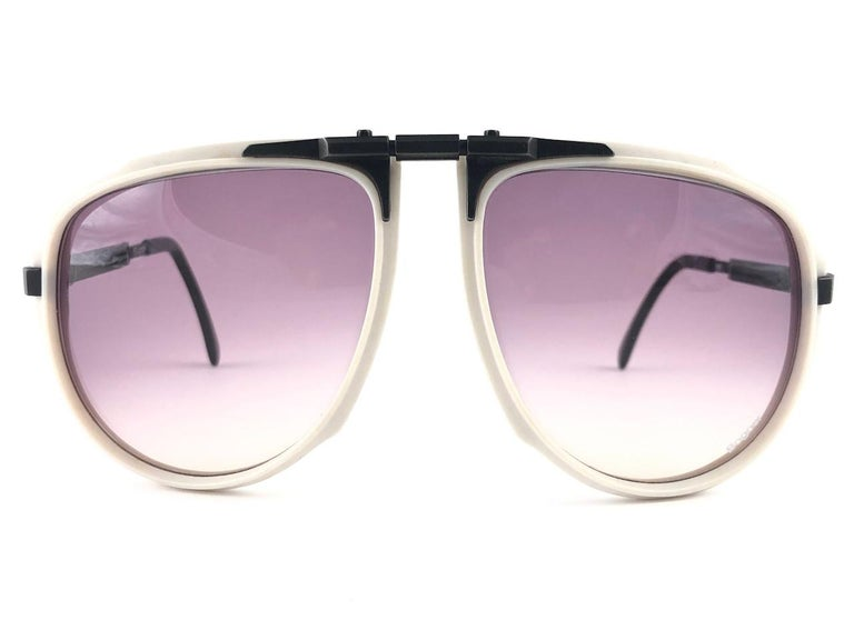 Super rare item.   New vintage Bogner by Eschenbach sunglasses 7003 white & black with rose gradient lenses. The exact same model used by the late Roger Moore in a