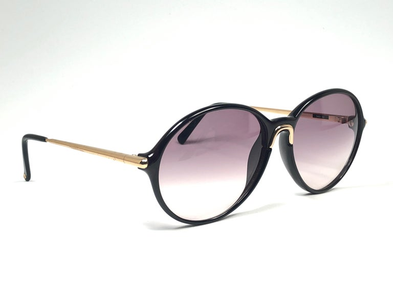 New 1980's Carrera by Movado tortoise frame with grey lenses.   Amazing craftsmanship and quality.    This item has some wear on it due to nearly 40 years of storage.   New, never worn. Made in Austria.
