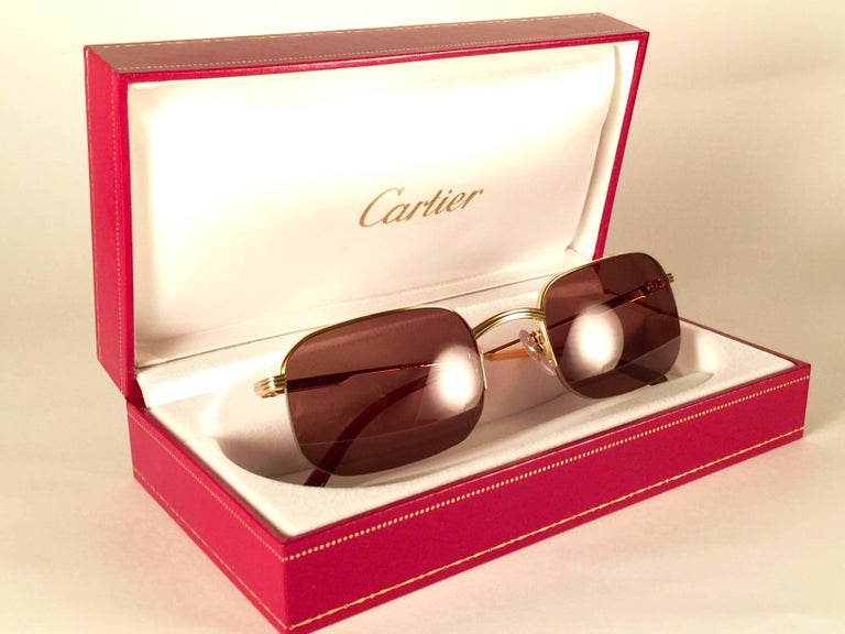 New 1990 Cartier Broadway half frame Vendome 51 [] 23 Sunglasses with brown (uv protection) lenses. All hallmarks. Cartier gold signs on the ear paddles. These are like a pair of jewels on your nose. Please notice that this sunglasses are nearly 30