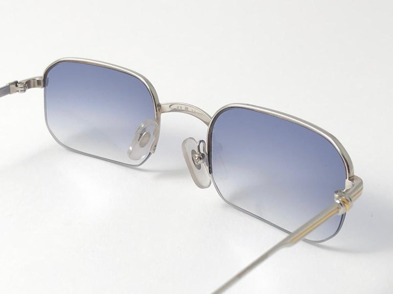 New 1990 Cartier Broadway half frame Vendome 49 [] 22 Sunglasses with blue gradient (uv protection) lenses. All hallmarks. Cartier gold signs on the ear paddles. These are like a pair of jewels on your nose. Please notice that this sunglasses are