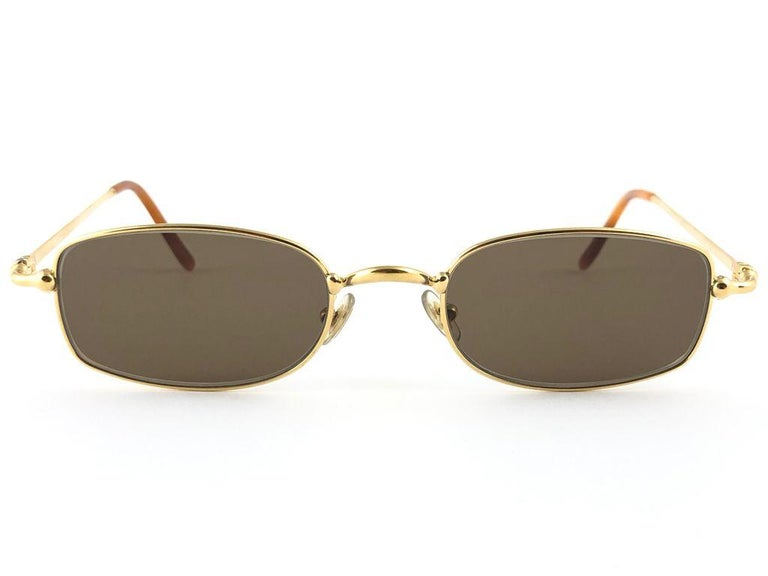 New 1990 Cartier Sasdir 51 MM Sunglasses with brown (uv protection) lenses.  All hallmarks. Cartier gold signs on the ear paddles. These are like a pair of jewels on your nose. Beautiful design and a real sign of the times. Original Cartier hard