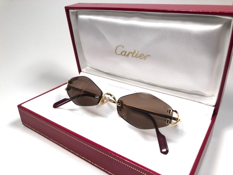 9cce284b51bc New 1990 Cartier Soho unique rimless sunglasses with brown original Cartier  (uv protection) lenses
