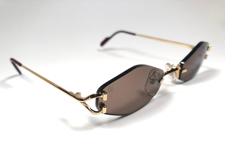 f7a76f7b22eba New Vintage Cartier Soho Gold Rimless Brown Lens France Sunglasses In New  Condition For Sale In
