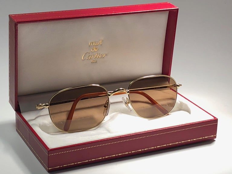 New 1990 Cartier Vesta Sunglasses with brown (uv protection) lenses. All hallmarks. Cartier gold signs on the ear paddles. These are like a pair of jewels on your nose.  Please notice that this sunglasses are nearly 30 years old and could show minor