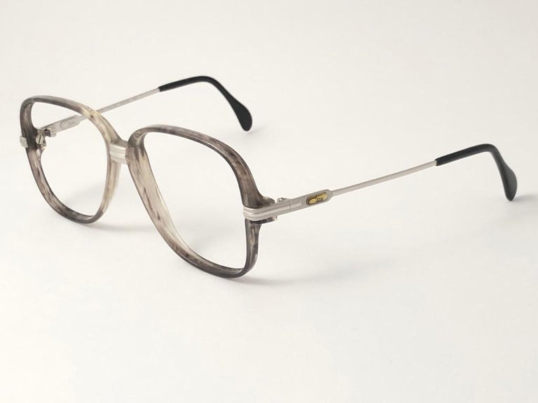 New Vintage Cazal 620 Marbled & Silver  frame. Perfect for reading spectacles.  This item may show minor sign of wear due to almost 30 years of storage. Made in W. Germany.  Front   14  cms Lense Height   5  cms Lense Width    5.7  cms Temple  12.5